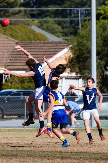 Dear (19) and __ playing in their first match of the carnival against ACT in Geelong. Photo: Cherie Dear.